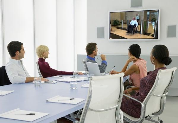 People watching orientation video